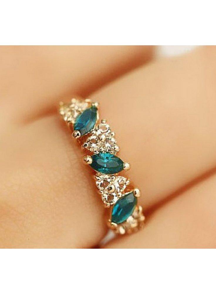 Anello con pietre di colore smeraldo - omaggio con 80 euro di spesa